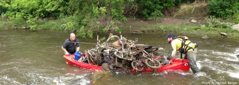 River trash being hauled out of the Portneuf by canoe. Photo by: Hannah Sanger